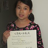 Holding her yellow belt certificate for Aikido