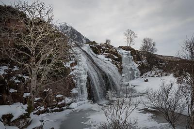 A running and a frozen waterfall in Allt Airdeasaidh