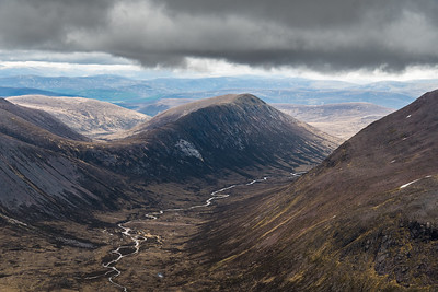 Carn a' Mhaim in the distance under a canopy of rain clouds