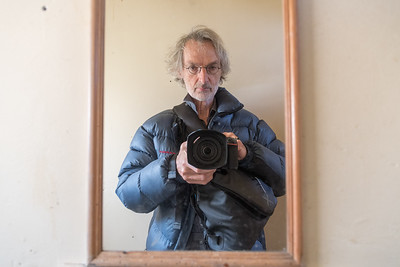 Self-portrait in camping loo