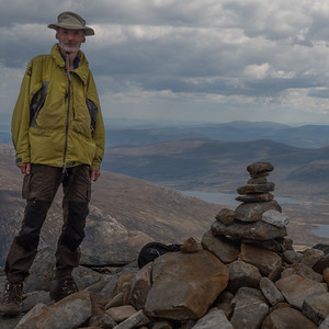 A young American lady kindly offered to take my picture next to the wee cairn of Cona Mheall