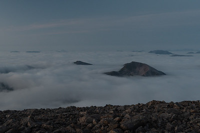 Summits poking through the cloud layer, close to sunrise