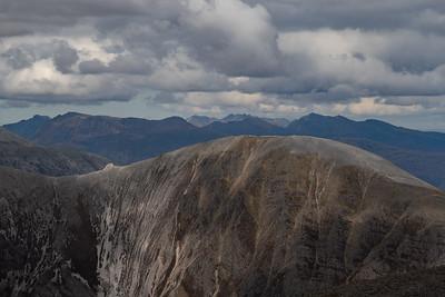 The serrated ridge of An Teallach on the horizon