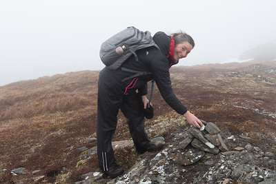 Ilona adding a stone to a summit cairn