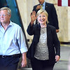 Hillary Clinton walking out with President of Futuramic, Mark Jurcak, in Warren..  Ray Skowronek--The Macomb Daily
