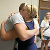 Hillary A. (Bartlett) Newsome Foundation, also known as Hillary's Chucks, delivered 50 backpacks to the Leominster School District on Friday morning, August 23, 2019. Leominster School District Superintendent Paula Deacon Thanked each member of the foundation with a hug. Here she hugs Hillary's Brother Nick Bartlett. Looking on is foundation member Jen Perla. SENTINEL & ENTERPRISE/JOHN LOVE