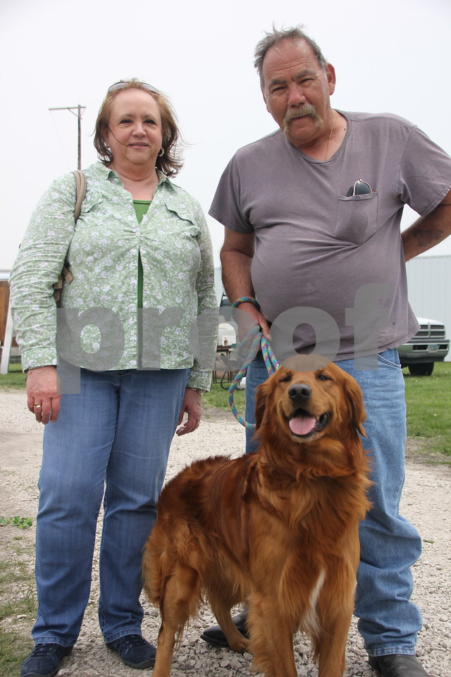 Saturday, May 7. 2016 the Webster County Fairgrounds in Fort Dodge held the Hillbilly Sale Flea Market. Seen here is( left to right): Brenda and Denny Smith, one of many attendees enjoying the event, with their dog Mutley.