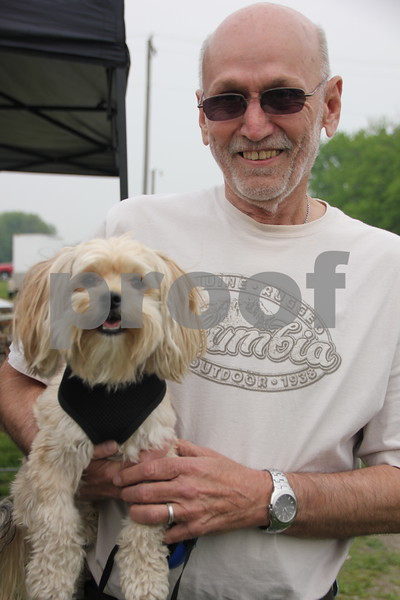 Saturday, May 7. 2016 the Webster County Fairgrounds in Fort Dodge held the Hillbilly Sale Flea Market. Pictured here is: Don Anderson with his dog Oscar, who were out enjoying  the event.