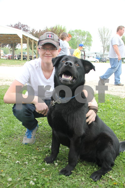 Saturday, May 7. 2016 the Webster County Fairgrounds in Fort Dodge held the Hillbilly Sale Flea Market. Pictured here is: Zeb Katschke with his dog Samson. Zeb was one of the many people who came out to enjoy the event.