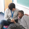 BEN GARVER — THE BERKSHIRE EAGLE<br /> Romello, 15, who has autism, is comforted by Shayla Bowman, the academic supervisor  at Hillcrest Academy in the former St. Marks School building in Pittsfield, Monday January 8, 2018. Hillcrest Academy is a school for students with autism, social and emotional disorders and others students who require the highest level of professional services.