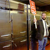 Stanless Steel refrigerators  go for $10 as auctioneer Zach Lewis looks for bidders during the Hilltop Steak House auction Saturday Dec 14 . Wicked Local Staff Photo / Nicole Goodhue Boyd