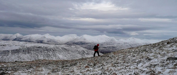Ben Nevis and the Mamores make a great background to John's lonely figure