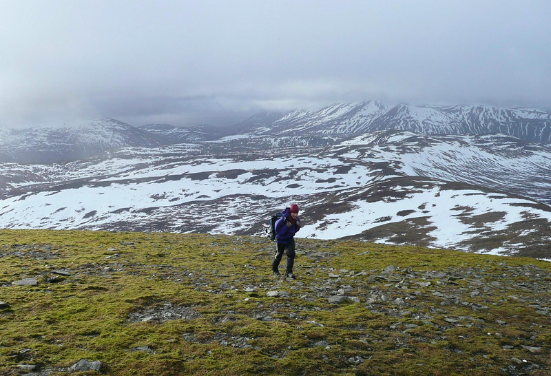 Martine battling against the wind near the top of Glas Tulaichean.