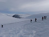 Crossing the Cairngorm plateau, with the Shelter Stone crag in the background