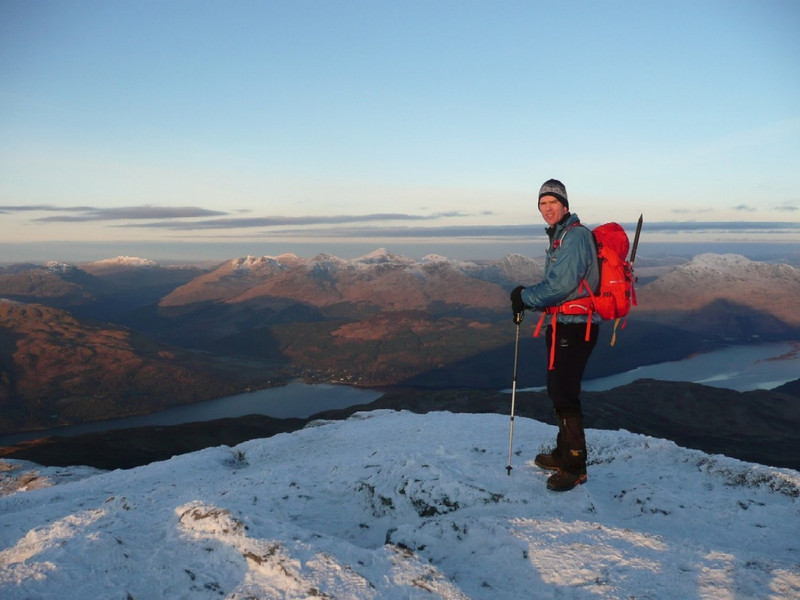 Summit of Ben Lomond with Arrochar hills across Loch Lomond