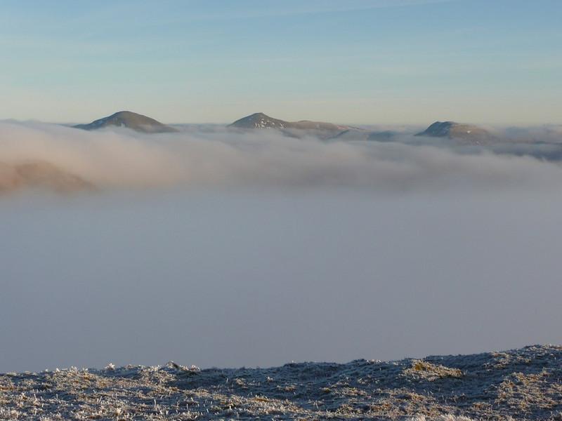 Ben More, Stob Binnien and Cruach Ardrain poking through the cloud