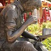 Statue of boy reading in Harbour Town in Hilton Head, SC