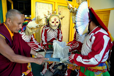 Dance of the masters of the cremation ground- dancers prepare before the dance