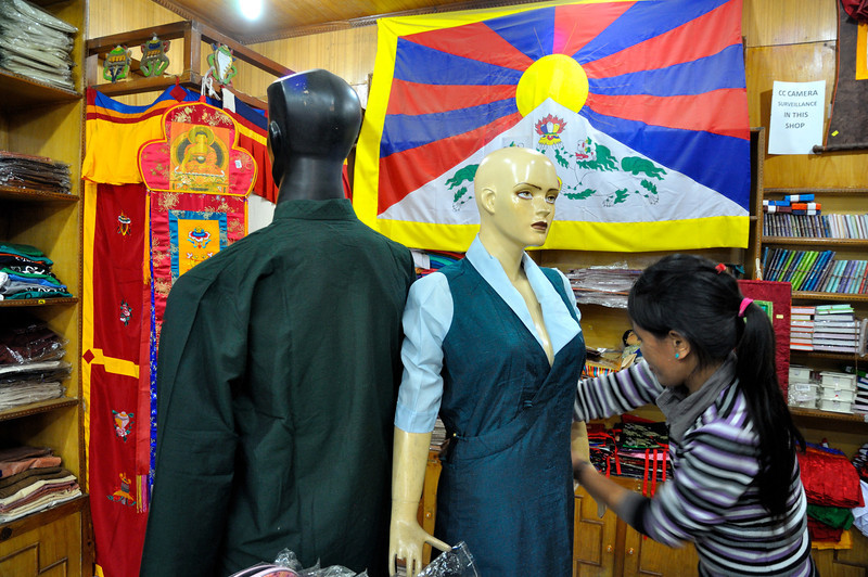 Dressing a mannequin in a shop in Mcleodganj