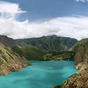 Panorama of the bottom half of Phoksundo lake. The outlet is centre right. Nothing lives in this lake besides Caddis fly larvae. Note the trail to the right which features in the film 'HIMALAYA'.