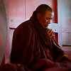 Monk at payer in Tengboche Monastery