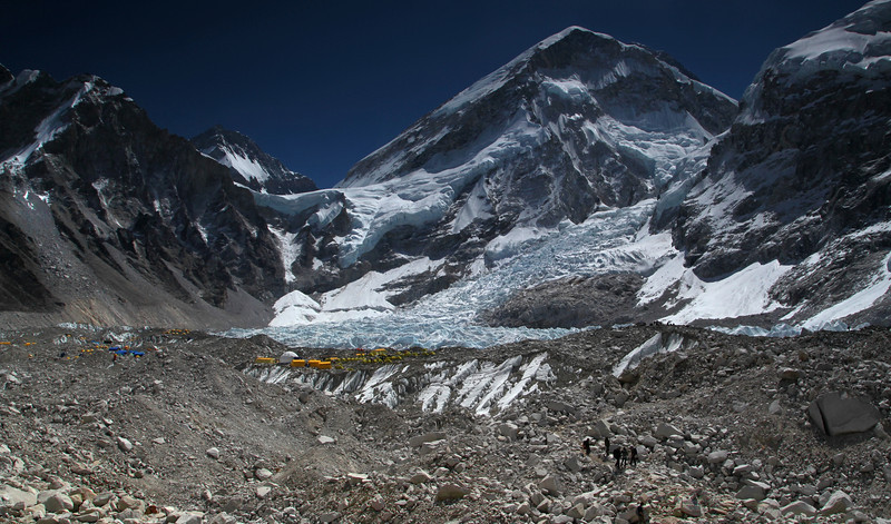 Arriving at EBC. The rocky moraine is treacherous underfoot. From here you can just see Everest peeping round over the ice-fall which is the last view of it you'll see unless you go on to climb it.