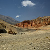 On the Charang to Lo Manthang road; chortens and the red ochre coloured bluffs.