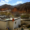 Looking across the valley from the Chosur gompa. In the bluff (left of center) you can see holes which are the openings  of an extensive 'cave' system with about 6 galleries. These have been used for many centuries.
