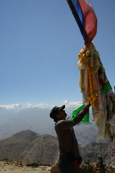 At Yamda La (3860m). Yuba doing the honours with the prayer flags.