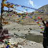 Lama adjusting the prayer flags