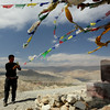 Finally we reach the pass overlooking Lo Manthang. Lama sees to the prayer flags.