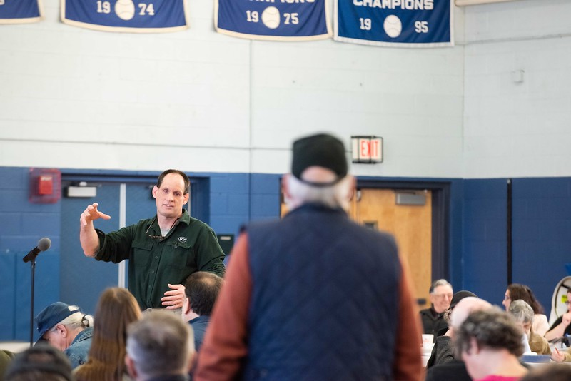 KELLY FLETCHER, REFORMER CORRESPONDENT -- Steve Gassett, head of the building committee in Hinsdale, answers a question pertaining to the possible relocation of the Fire Station during town meeting on Saturday.