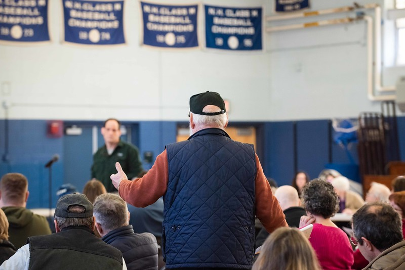 KELLY FLETCHER, REFORMER CORRESPONDENT -- Paul Barnard asks a question of Steve Gassett pertaining to the possible relocation of the Hinsdale Fire Station during town meeting on Saturday.