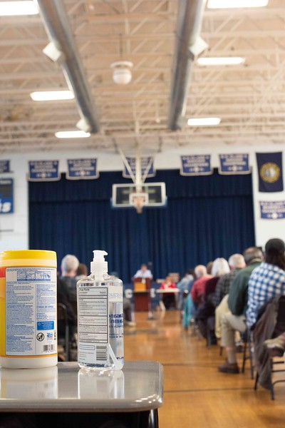 KELLY FLETCHER, REFORMER CORRESPONDENT -- disinfectant wipes and hand sanitizer attend town meeting in Hinsdale on Saturday.