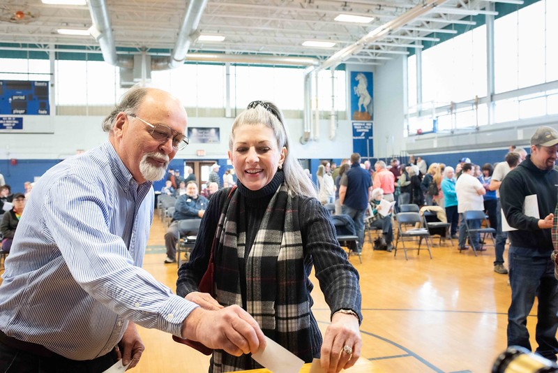 KELLY FLETCHER, REFORMER CORRESPONDENT -- Richard and Angela Schill cast their votes for SB-2 at Hinsdale's town meeting on Saturday.  SB-2 would replace town meeting and allow official ballot voting on all issues before the Town of Hinsdale on the 2nd Tuesday of March.