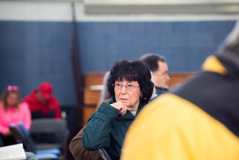 KELLY FLETCHER, REFORMER CORRESPONDEN T-- A Hinsdale resident listens to discussion about the fire station building fund during town meeting on Saturday.