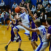 KRISTOPHER RADDER — BRATTLEBORO REFORMER<br /> Hinsdale's Dan Tetreaulet leaps up into the air as he tries to take an attempt on basket while being covered by Nute's defense during a varsity basketball game at Hinsdale, N.H.,  Middle High School on Friday, Jan. 31, 2020.