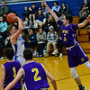 KRISTOPHER RADDER — BRATTLEBORO REFORMER<br /> Hinsdale's Tanner Hammond shoots the ball as Nute's Kyle Powers leaps into the air to try and block it during a varsity basketball game at Hinsdale, N.H.,  Middle High School on Friday, Jan. 31, 2020.