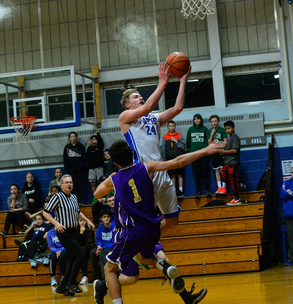 KRISTOPHER RADDER — BRATTLEBORO REFORMER<br /> Hinsdale's Dylan Harden leaps into the air during a varsity basketball game at Hinsdale, N.H.,  Middle High School on Friday, Jan. 31, 2020.