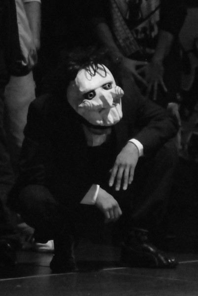 Rule #4081: If you are wearing a costume, know how to use it.  When he saw the camera he dropped his head so I could see the mask he had lifted up on top...  Thanks bro.