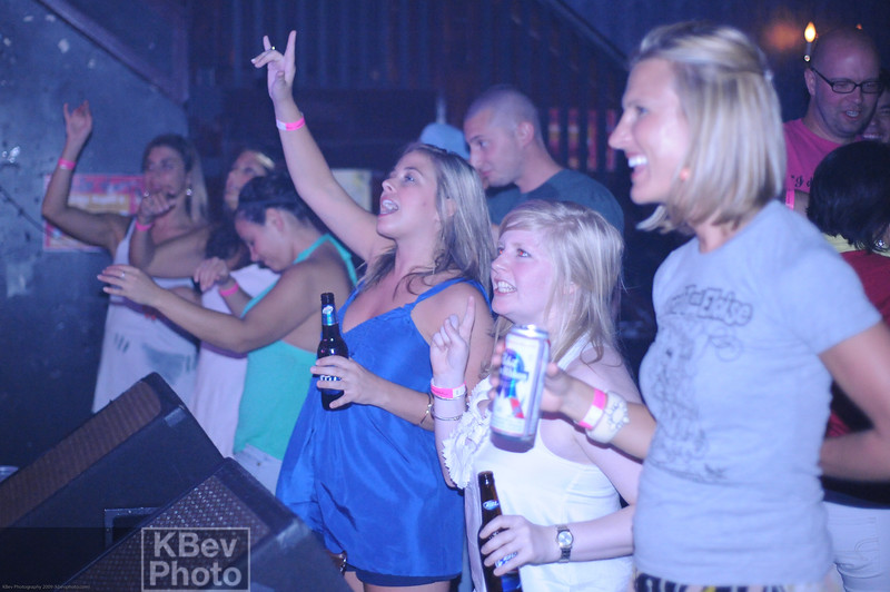 Amazingly, the girl in blue knew the words to almost every song.  The one in the gray t-shirt is the one with the signs