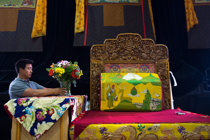 "BEST BEST BEST <br /> <br /> Amdo Nyima arranges flowers on the stage as he helps the Tibetan Association of Colorado prepare for the Dalai Lama's visit in the Coors Event Center at CU Boulder on Wednesday. <br /> More photos:  <a href=""http://www.dailycamera.com"">http://www.dailycamera.com</a><br /> (Autumn Parry/Staff Photographer)<br /> June 22, 2016"