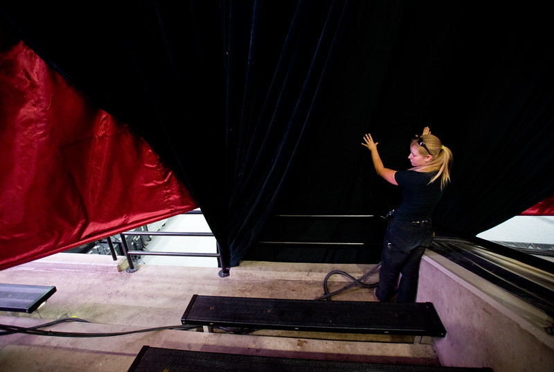"Molly Goodman, with Rhino Staging, helps set up the stage area as they prepare for the Dalai Lama's visit in the Coors Event Center at CU Boulder on Wednesday.<br /> More photos:  <a href=""http://www.dailycamera.com"">http://www.dailycamera.com</a><br /> (Autumn Parry/Staff Photographer)<br /> June 22, 2016"