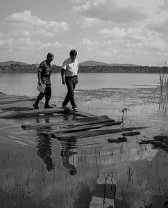 San Ignacio de Velasco, BOLIVIA.- The President of Bolivia, Evo Morales (right) walks on a almost sonk port during a visit to the Warnes Infantry Regiment. May 3 of 2009. Photo: Dany Krom.