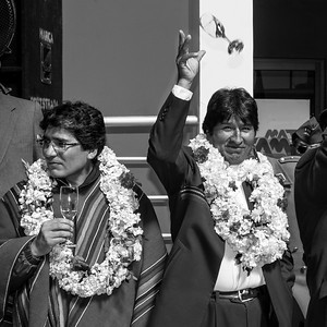 Uyuni, BOLIVIA.- The President of Bolivia, Evo Morales (right) throws his glass of champagne as a sign of good luck during the Uyuni Airport opening. July 11 of 2011. Photo: Dany Krom
