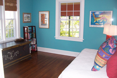 The second bedroom is bright and cheerful.  This room is quite spacious for the time period.