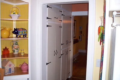 Space is not an issue, because there is ample storage in the roomy pantry cupboards in the hall between the dining room and kitchen.