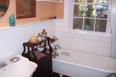 The second bathroom has been completely updated, but you will think it is straight out of the 1920's.  The wainscoting, clawfoot tub, and pedestal sink give the space the charm you would expect.  And what a plus to have a second bathroom in this vintage home.