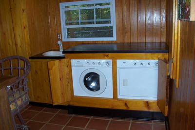 Beautifully built in Washer and Gas Dryer. The cabinets have been stained to match the walls. The top lifts off for maintenance and the face pulls away to allow repairs or removal of the units if needed.