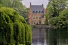 Many of Bruges beautiful buildings are nestled beside stone-walled waterways.